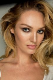 Candace Swanepoel looking fab with bold makeup and flowing hair at DVF