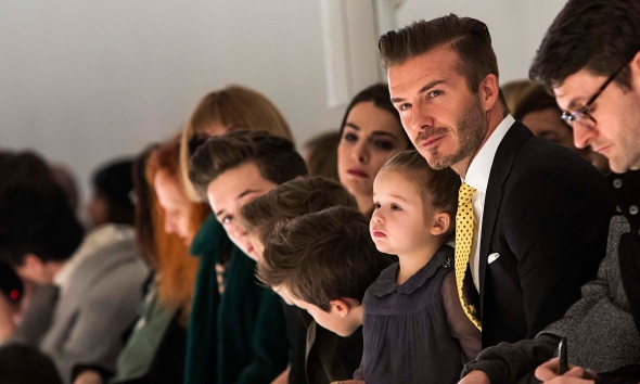 Gratuitous David Beckham shot ;) Front row with daughter Harper at the Victoria Beckham show.