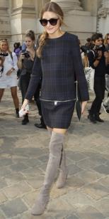 Olivia in a Zara plaid dress and Stuart Weitzman thigh-high boots