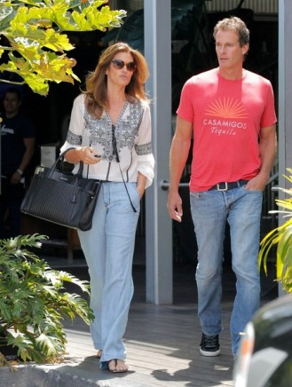 Cindy Crawford and Rande Gerber looking California casual while leaving Cafe Habana.