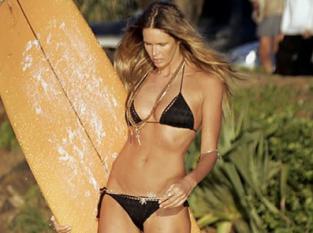 "Surfer Elle Macpherson is nicknamed ""The Body"" for good reason."