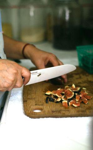 Jenny preparing food at Surya.